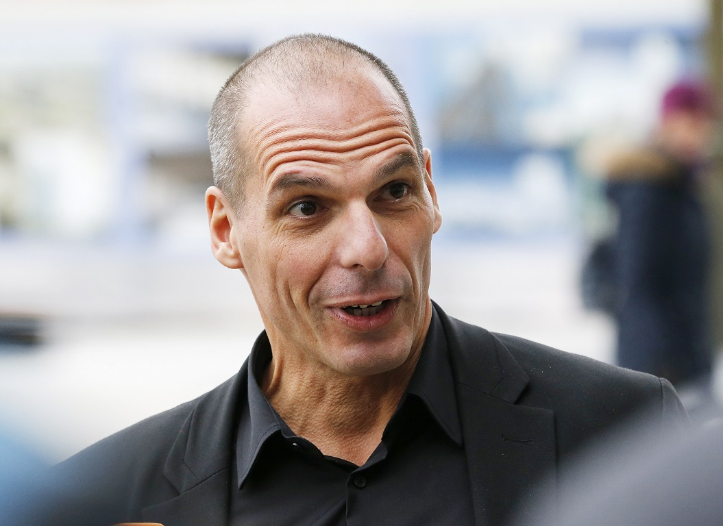 Greek Finance Minister Yanis Varoufakis speaks to journalists after a meeting with the President of the European Central Bank Mario Draghi in Frankfurt, Germany, Wednesday, Feb. 4, 2015. (AP Photo/Michael Probst)